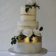 3 tier semi naked wedding cake with marbled sugarpaste bottom tier.
