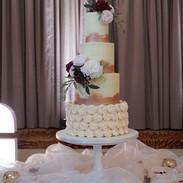 Elegant buttercream wedding cake with rosettes.