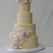Elegant 4 tier textured buttercream cake.