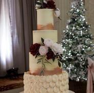 Elegant 4 tier buttercream wedding cake set up at Culloden Hotel, Cultra.