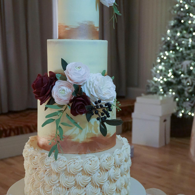 Elegant buttercream wedding cake set up in the Stuart Suite, Culloden Hotel.