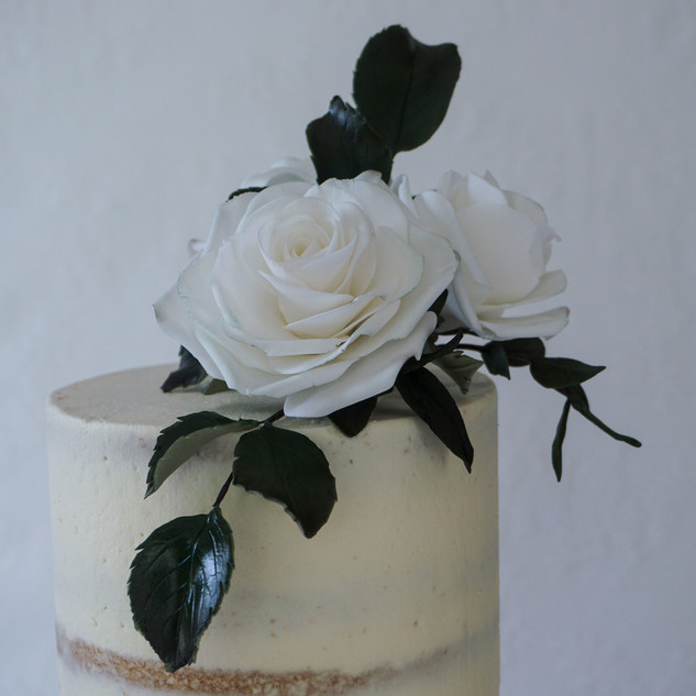 Detail of top sugar flower arrangement.