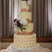 Elegant rose gold butterceam wedding cake.