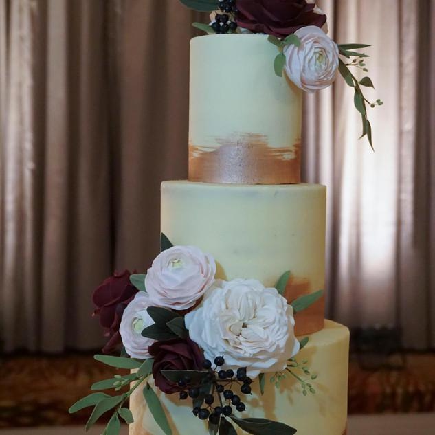 Elegant buttercream 4 tier wedding cake.