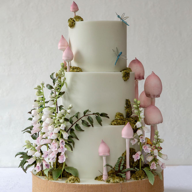 YK2B8147.jpgFondant covered wedding cake with natural arrangement of foxgloves and toadstools.