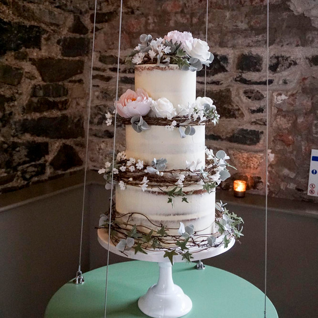 Gorgeous rustic buttercream wedding cake.