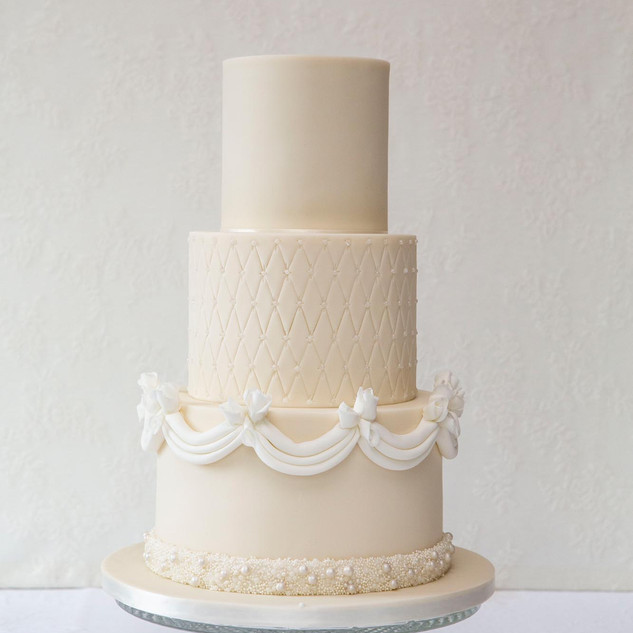 Elegant all ivory wedding cake.