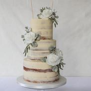 Semi naked buttercream cake.