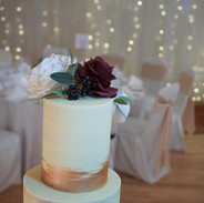 Buttercream cake with rose gold lustre.