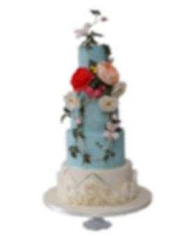 Pastel coloured wedding cake with handmade sugar flowers, rose ruffels and silver leaf detail.
