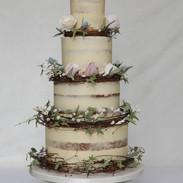 Rystic buttercream wedding cake with rattan wreaths.
