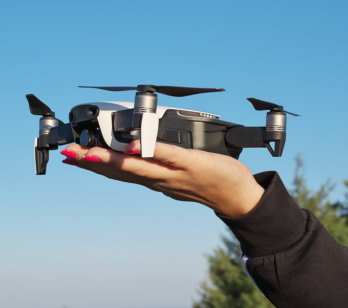 drone-landing-on-a-woman-hand-778TJGJ.jpg