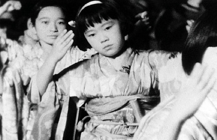 "Young dancers are shown as part of a Nisei Week ondo in a scene from ""Little Tokyo 1930s Home Movie,"" a compilation of home movies by Akira Kawasaki. (Visual Communications Photographic Archive)"