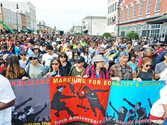 Kathy Masaoka (center left, holding phone) and June Hibino (to Masaoka's right) were among the thousands who took part in commemorating the 50th anniversary of the Selma-to-Montgomery march in Selma, Ala., on March 8. (Photo by Mike Murase)