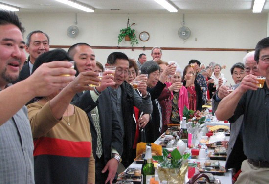 Attendees drink a toast to the Year of the Monkey with sparkling cider.