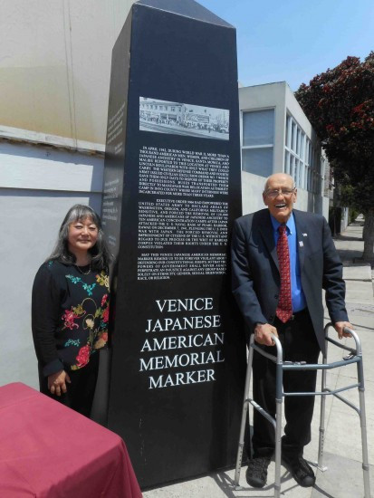 Phyllis Hayashibara of the VJAMM committee and former Los Angeles City Councilmember Bill Rosendahl with a full-scale model of the monument on April 23, 2015.