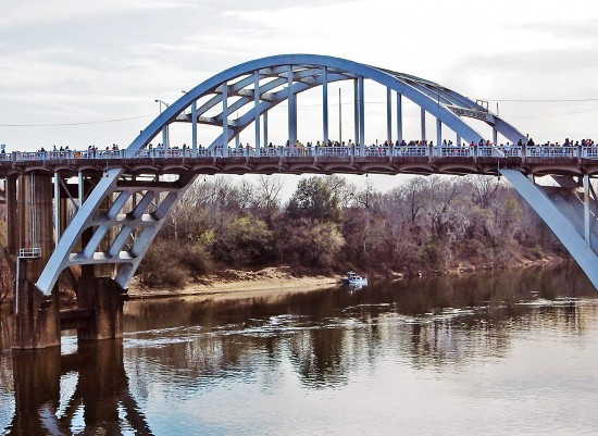Thousands marched across the Edmund Pettus Bridge, walking peacefully and singing freedom songs.