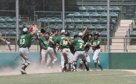 The Lodi JACL Templars celebrate their victory at the plate.