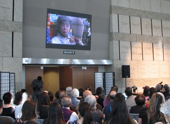 "The late civil rights activist Yuri Kochiyama appears in the video ""9066 to 9/11,"" part of which was screened at the DOR program. (J.K. YAMAMOTO/Rafu Shimpo)"