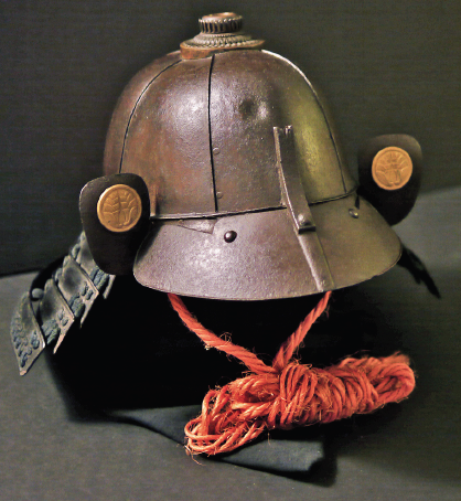 A samurai helmet by Myochin Masuda Sadakatsu bearing three bullet test indentations.