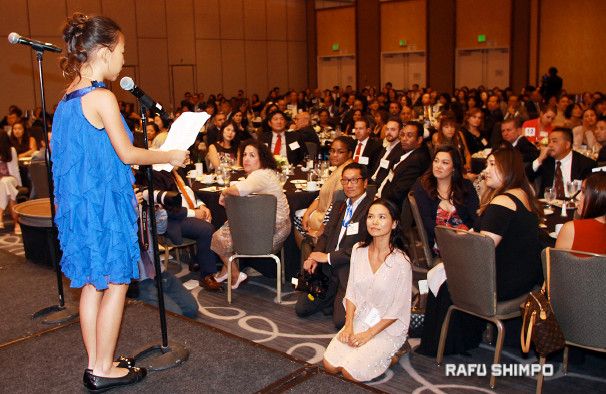 Kaili Nguyen, a bone marrow recipient, bravely shares her personal story at the Hyatt Regency Long Beach. Her mom, Thao Nguyen, sitting in front, listens intently. Donor Mai Ha was to have joined her on stage, but was unable to attend.