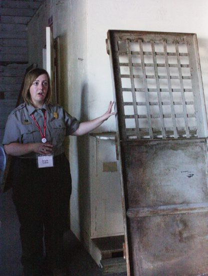 Angela Sutton with the National Park Service leads a tour of the Tule Lake jail artifacts that were salvaged. (Photo by Martha Nakagawa)