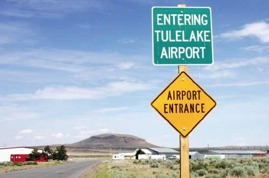 The road leading to the entrance of Tulelake Airport with Abalone Hill in the background. (Photo by Martha Nakagawa)