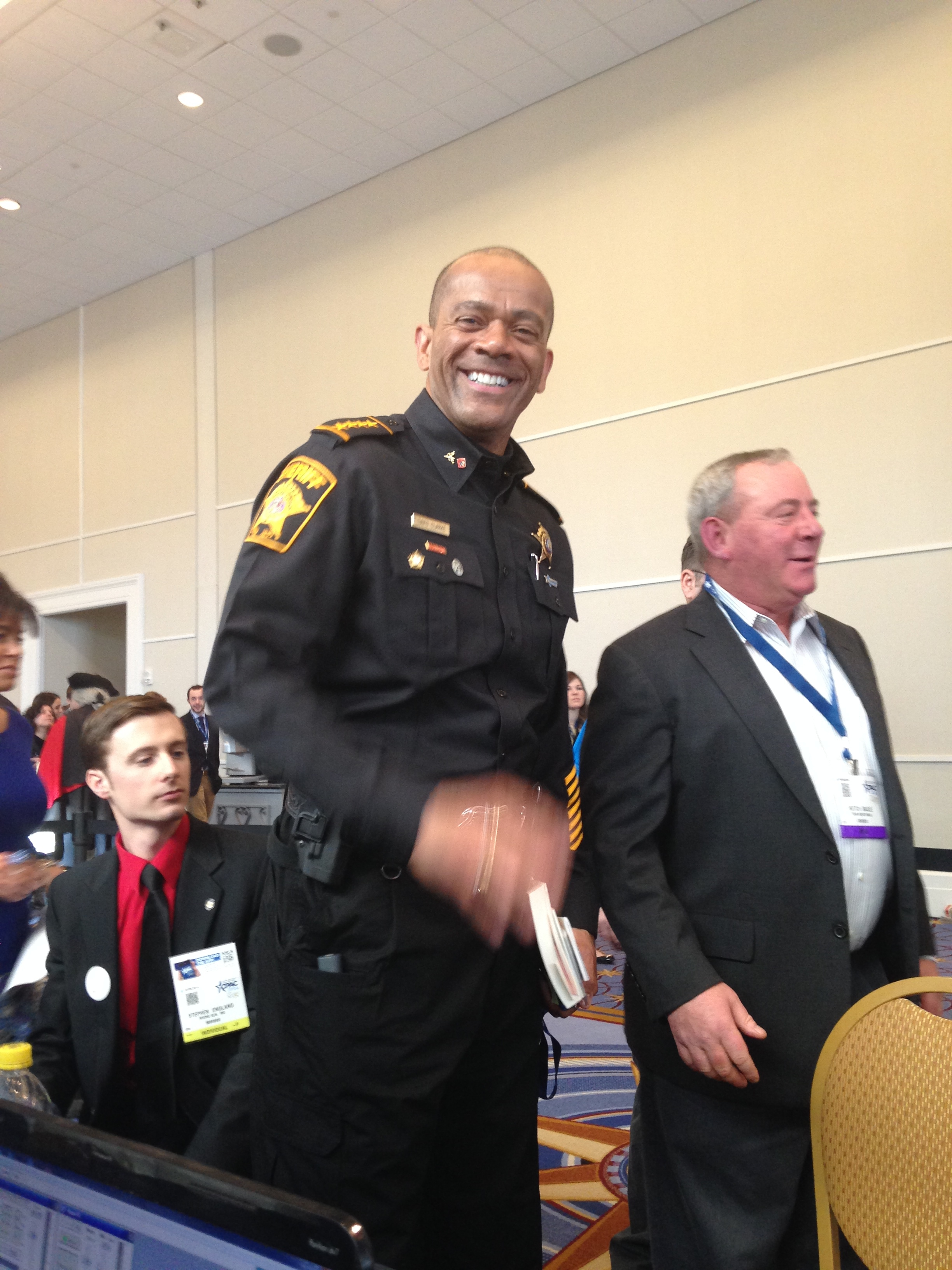 Sheriff Clarke gives a smil