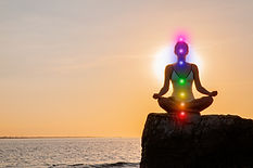 Woman is meditating with glowing seven c