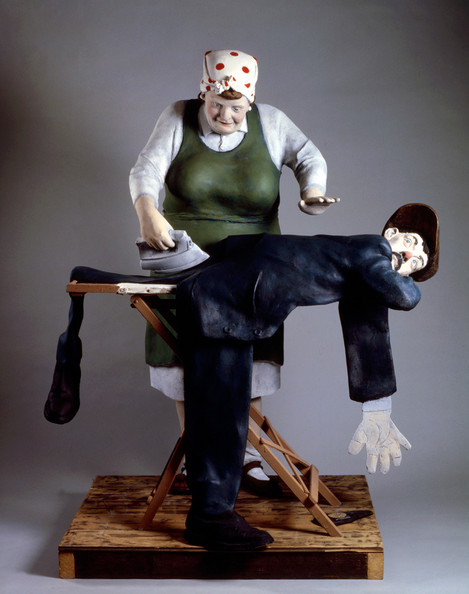 Woman Flattens Husban After He Comes Home from the Pub (fibreglass / mixed media)