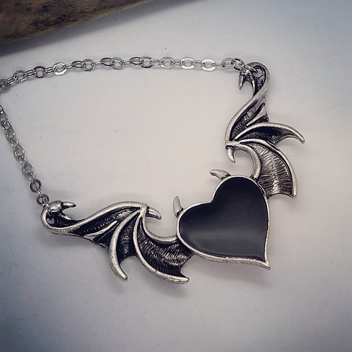 "Silvertone Heart with Batwings on 20"" Chain"