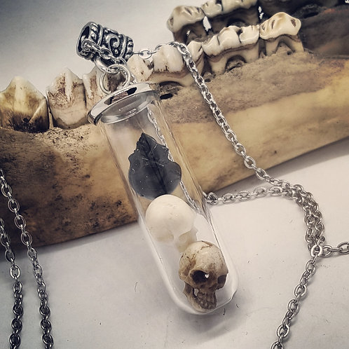 "Tiny Vial with Carved Skulls on 20"" Chain"