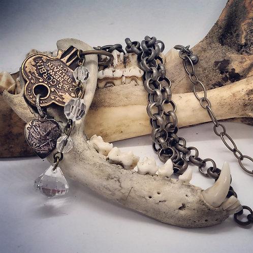 Real Raccoon Jawbone with Key & Acrylic Crystals