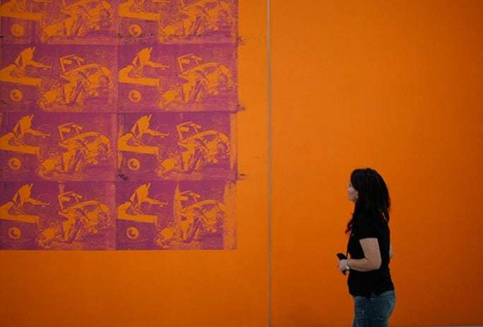 Lui's inspiring painting by Andy Warhol.Here a woman looks at Andy Warhol's silkscreen painting Orange Car Crash during a preview of the exhibition Museum of Wishes at Vienna's Museum Moderner Kunst after its 2011 redesign. REUTERS/Lisi Niesner.