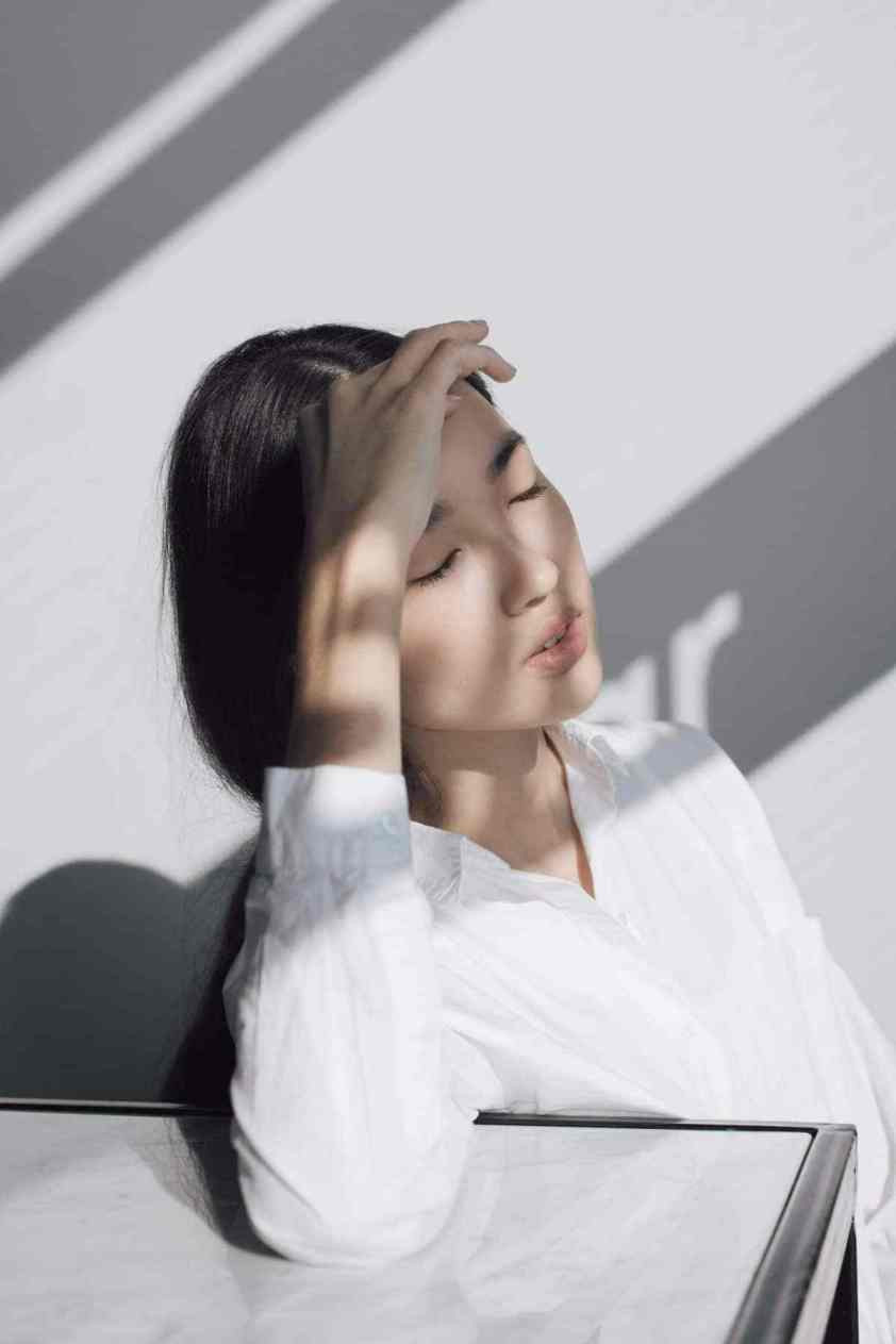 Photo of Woman resting head on her hand. Samso Insights