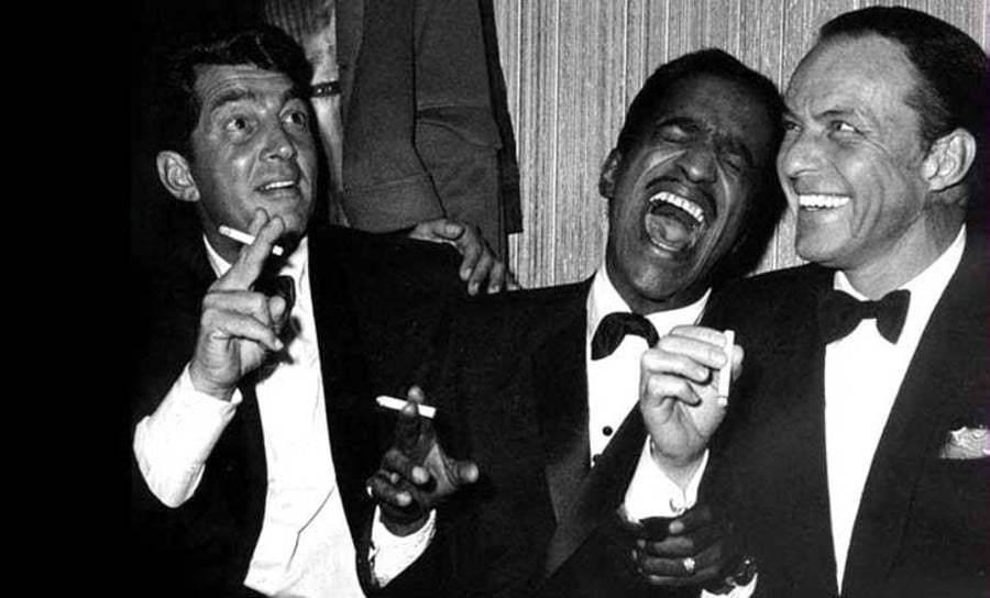 Black and white picture of men in suits laughing