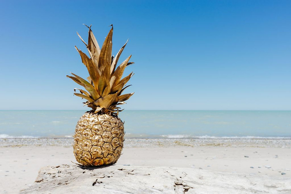 image of a golden pineapple on a beach. Samso Insights
