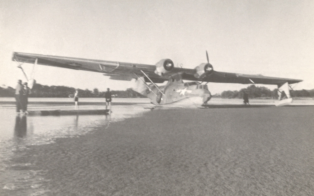 Bob Hope's PBY Catalina 'Spare Gear' aground on the eastern end of the sand-spit opposite the Dunbogan Boat Shed. Note the missing propeller.