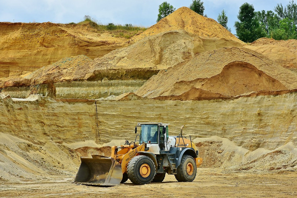 Image of sand mining in process. Samso Insights