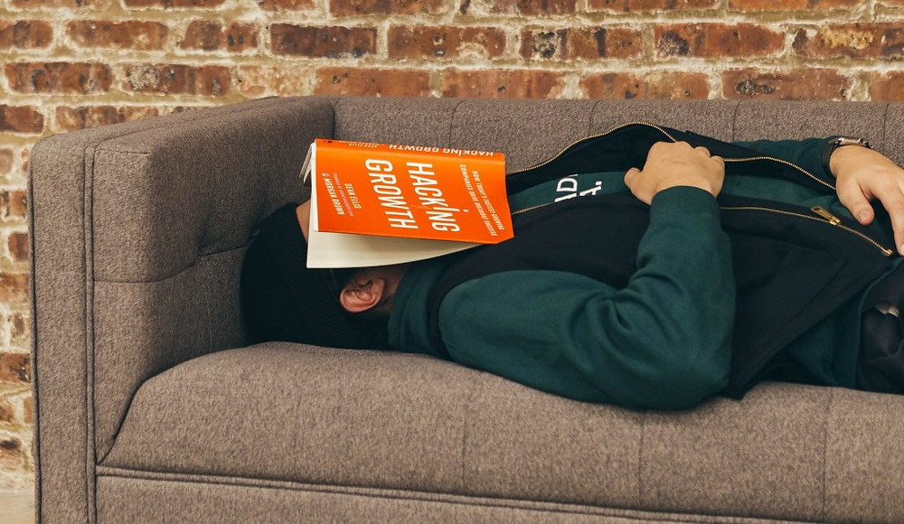 Photo of broker lying down on sofa after hearing of new cobalt play. Samso Insights.