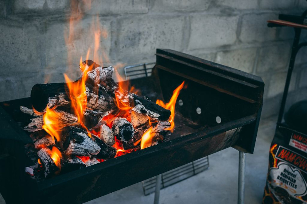 Image of coal BBQ with flames. Samso Insights.