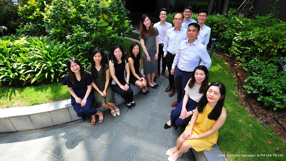 Mr Tan Cheng Chuah, MD (standing, third from left) with the young and dynamic project managers of PM Link.