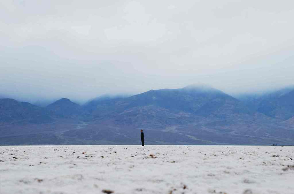 Photo of Man standing in salt desert. (source: Photo by Jenny Salita on Unsplash) Samso Insights