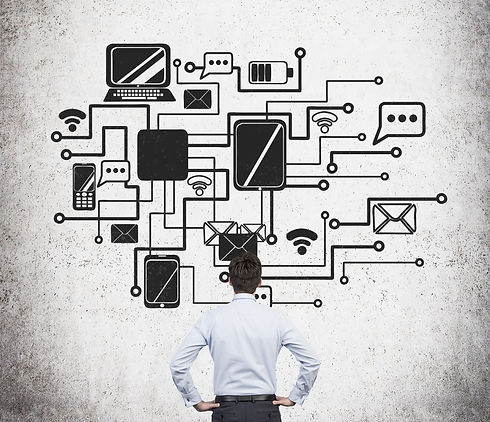 Businessman is standing in front of the flow chart of a corporate internal network..jpg