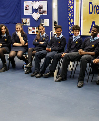 Gladesmore Community School, partner organisation, social mobility, opportunities, bursaries, Royal National Children's SpringBoard Foundation, Tony Hartney, boys and girls, school uniform, classroom, smiling, laughing, blue carpet