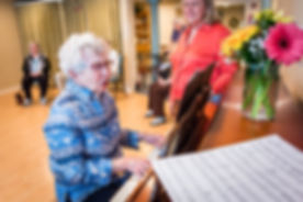 woman playing a piano at summercrest senior living community