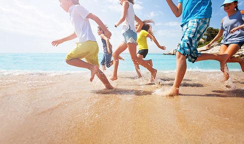 close-running-kids-legs-shallow-sea-7265