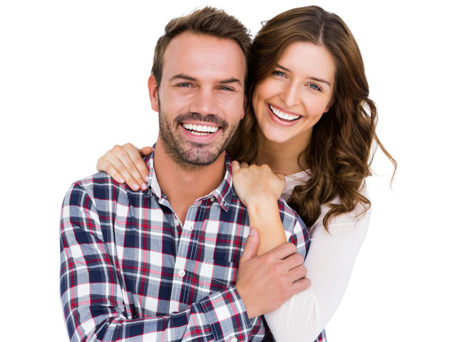 Portrait of young couple smiling on whit