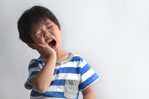 kid with tooth pain.jpg