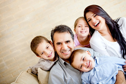 Portrait of a happy family smiling at ho